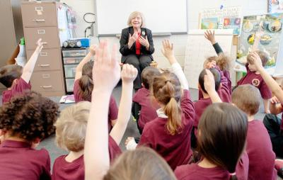 Grace Tillinghast asks questions of kindergartners during a Jan. 14 visit to Irondequoit's St. Kateri School, where she teaches Spanish to kindergarten and first-grade students.