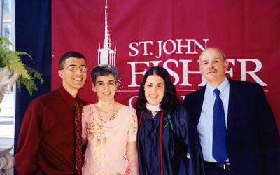 <p><i>Catholic Courier </i>New Media Coordinator Gina Capellazzi (center) with her brother, Mark; mom, Pat and father, Robert, at her college graduation in 2006. (Photo courtesy of Gina Capellazzi)  </p>