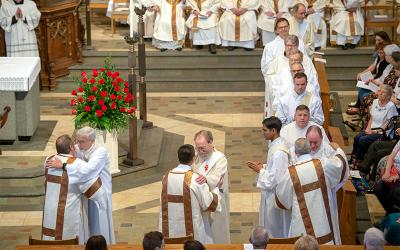Permanent deacons line up to congratulate the newly ordained during the May 26 Deacon Ordination Mass.