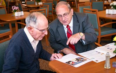 Father Tom Dugan speaks with Jim Alessi, Legion of Mary's Rochester Comitium, during a visit to the Sisters of St. Joseph Motherhouse in Pittsford, June 1.