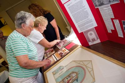 Florence Pavlina (front) and Marilyn Zazzara (rear) look at a display of memorabilia June 25 at St. Charles Borromeo Church in Elmira.