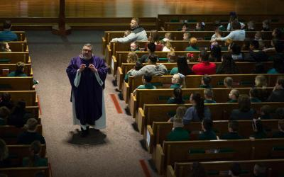 Father Larry McBride of Holy Name of Jesus Catholic Church in Henderson, Ky., delivers the Homily during a school Mass March 28. (CNS photo by Tyler Orsburn)