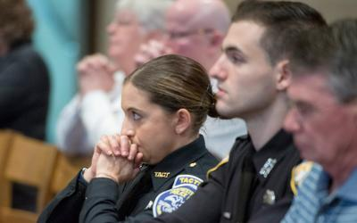 Amy Bauer of the Rochester Police Department prays Oct. 14 during the annual Blue Mass at Sacred Heart Cathedral.